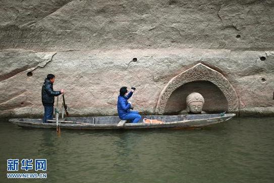 江西南城一水库发现摩崖造像 佛头遗迹浮出水面